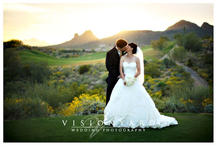 A photo by Visionyard Wedding Photography of a couple embracing on their wedding day at Eagle Mountain Golf Club